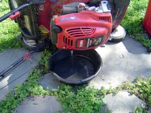 should i change oil in my lawn mower spring or fall
